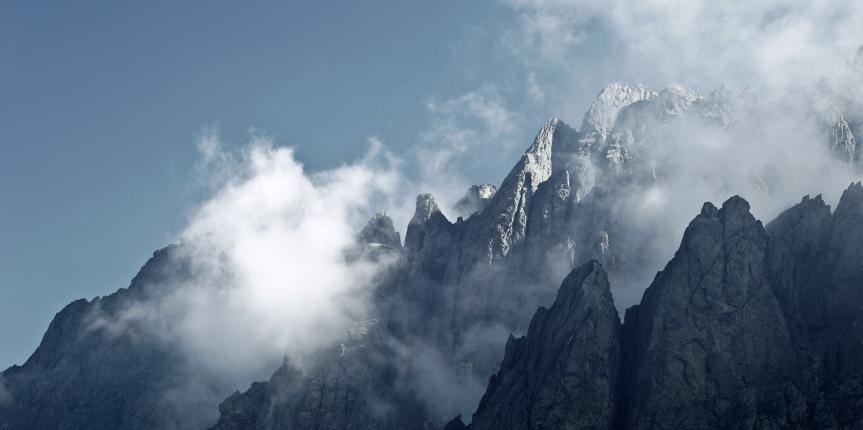 Impressive high mountain view – mountain peaks in mist